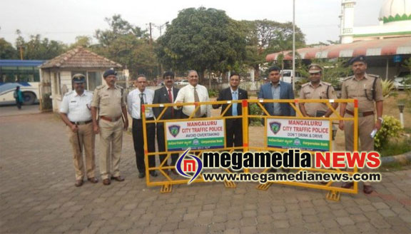 Corporation Bank handovers 100 traffic barricades to Police Department